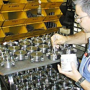 Back inside the building and next to the grinding room, the chuck department assembles and tests each 3-jaw and 4-jaw chuck. In this photo, lubrication is being applied to a batch of 4-jaw chucks. Over 25 years of making our own chucks has allowed us to continually improve their accuracy while keeping costs down.