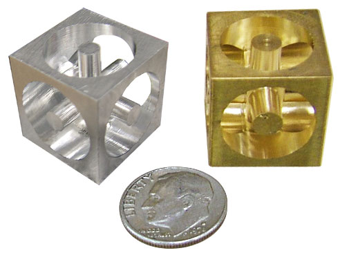 Finished cubes in aluminum and brass
